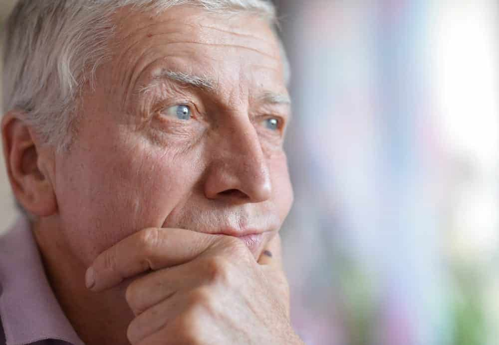 Senior man with thoughtful, worried expression